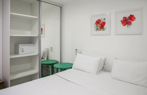 Cama ou camas em um quarto em Passeio das Palmeiras
