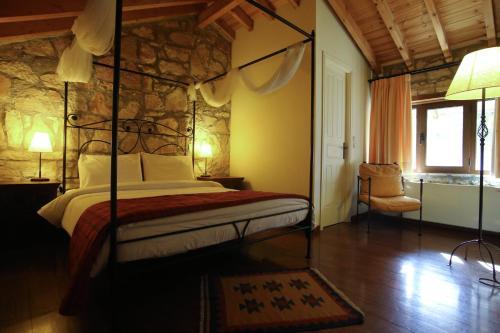 מיטה או מיטות בחדר ב-Princess Lanassa