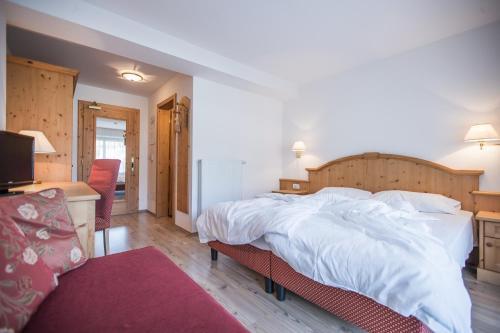 Ein Bett oder Betten in einem Zimmer der Unterkunft Hotel Innerhofer