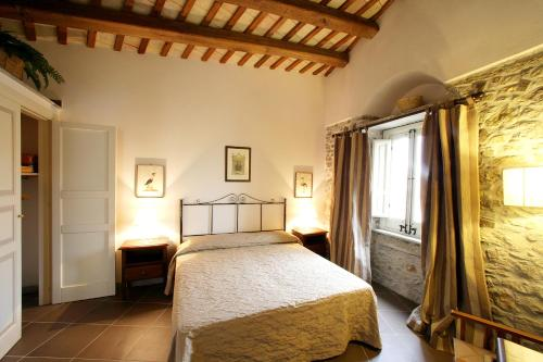 A bed or beds in a room at Residence Erice Pietre Antiche & rooms