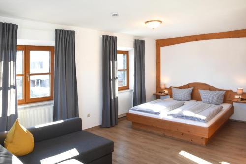 A bed or beds in a room at Alps Hostel