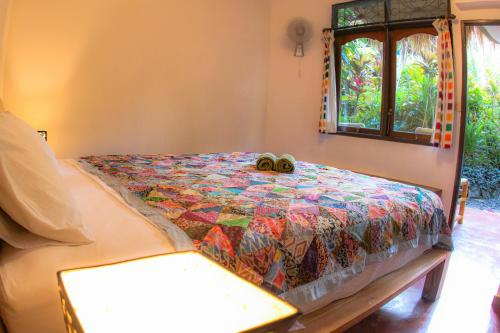 Tempat tidur dalam kamar di Rumah Semanggi