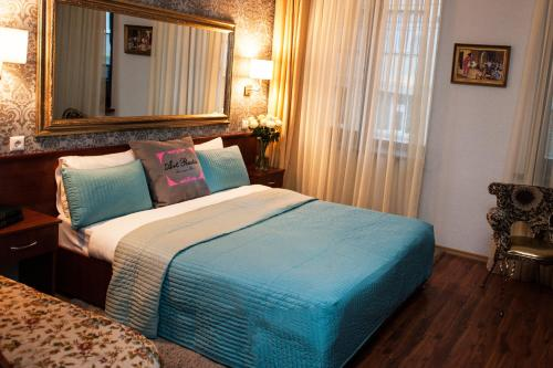 A bed or beds in a room at Art-Rustic Boutique Hotel
