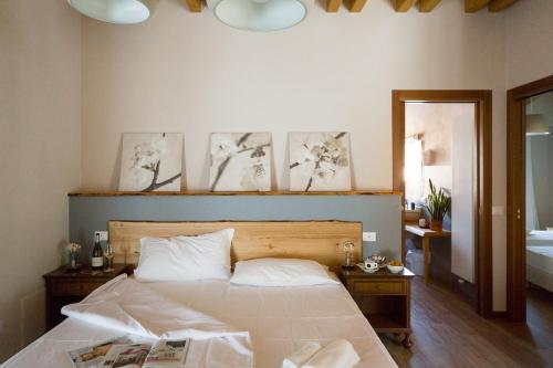 Postel nebo postele na pokoji v ubytování Locanda All'Avanguardia