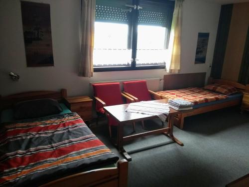 Posteľ alebo postele v izbe v ubytovaní Ubytovanie u Zuzany
