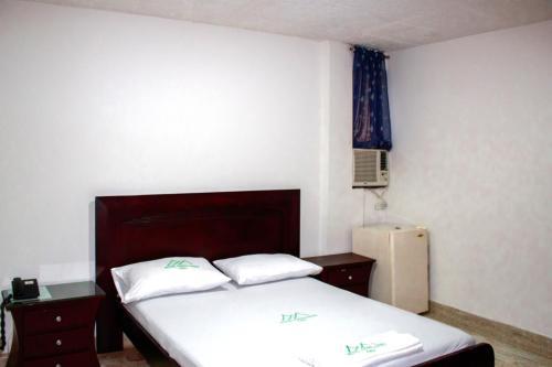 Кровать или кровати в номере Hotel Farallones Cali