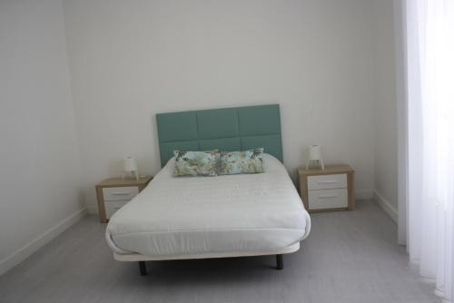 A bed or beds in a room at São Pedro Guest House