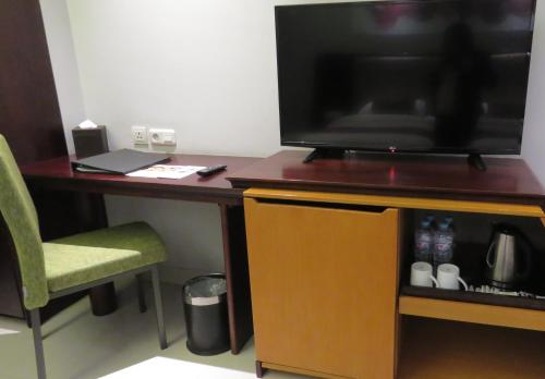 A television and/or entertainment center at Prime Plaza Hotel Kualanamu