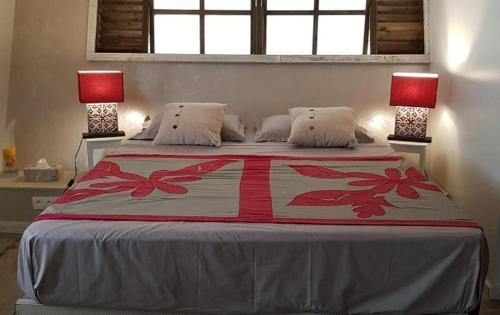 Cama ou camas em um quarto em Tanikai 1