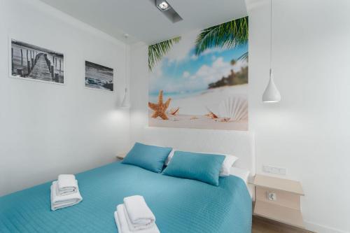 Łóżko lub łóżka w pokoju w obiekcie Horyzont 415