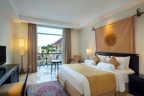 A bed or beds in a room at The Phoenix Hotel Yogyakarta - MGallery Collection - GeNose Ready, CHSE Certified