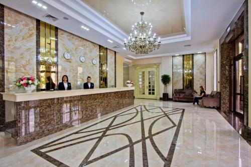 The lobby or reception area at Plaza Hotel Almaty
