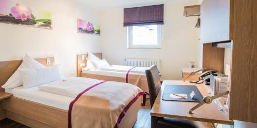 Ein Bett oder Betten in einem Zimmer der Unterkunft Hotel Das Kronprinz