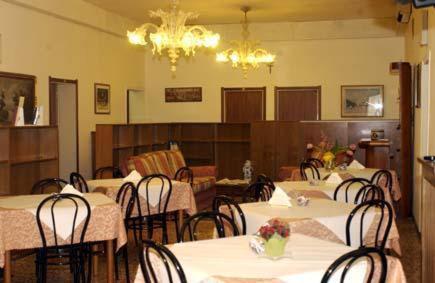 Restaurant ou autre lieu de restauration dans l'établissement Hotel Airone