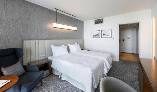 A bed or beds in a room at Makedonia Palace