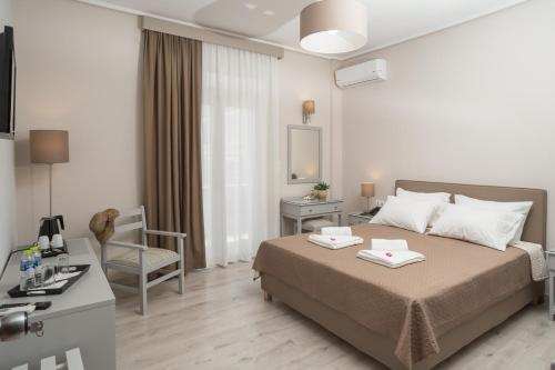Ένα ή περισσότερα κρεβάτια σε δωμάτιο στο Hotel Alkyon