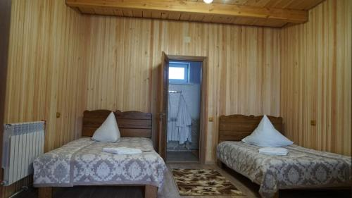 A bed or beds in a room at Barguzinskiy Priboy Inn