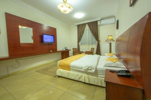 Cama ou camas em um quarto em The New Address Hotel
