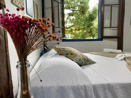 Cama ou camas em um quarto em Vila Pequeá Ilhabela
