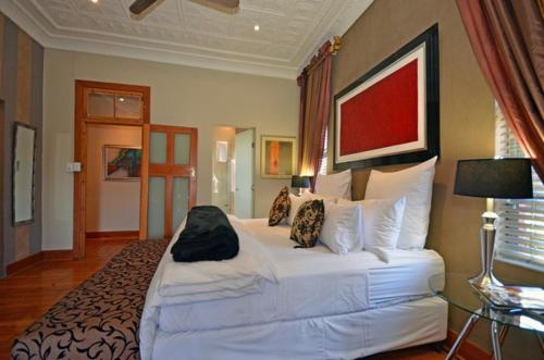 A bed or beds in a room at Saffron Guest House