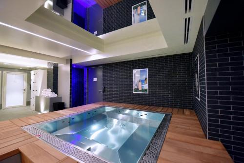 The swimming pool at or near Kyriad Hotel Dijon Gare