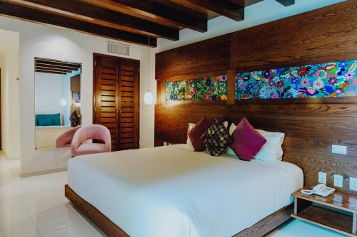 A bed or beds in a room at Soul Beach Boutique Hotel & Spa