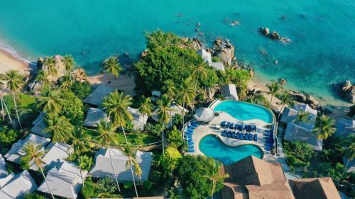 A bird's-eye view of Coral Cliff Beach Resort Samui - SHA Plus