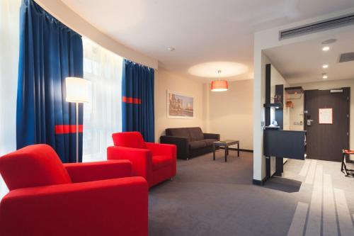 A seating area at Park Inn by Radisson Hotel Astana