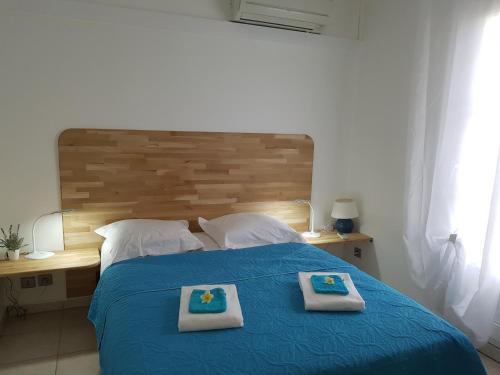 Un ou plusieurs lits dans un hébergement de l'établissement La Perle Marine