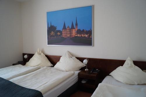 Кровать или кровати в номере Hotel Forsthaus St. Hubertus