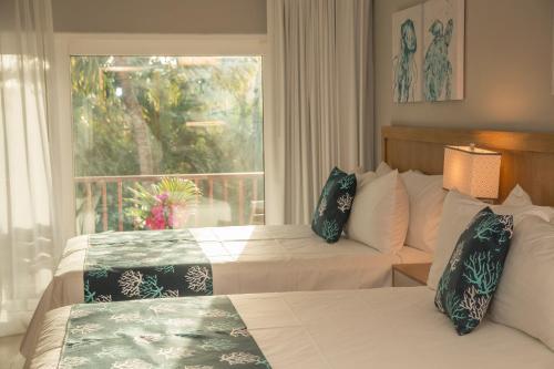 Cama o camas de una habitación en Siboney Beach Club