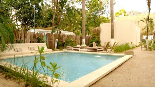 The swimming pool at or near Yaxa Hotel Nosara