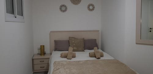 A bed or beds in a room at Neviot
