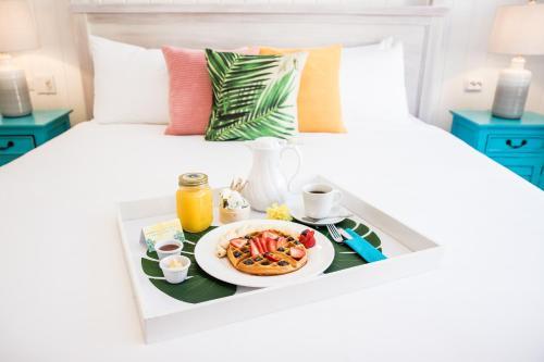 Cama o camas de una habitación en Boardwalk Boutique Hotel Aruba