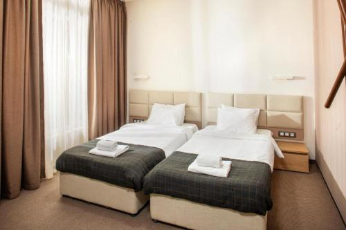 A bed or beds in a room at Park Hotel & Spa Boyana