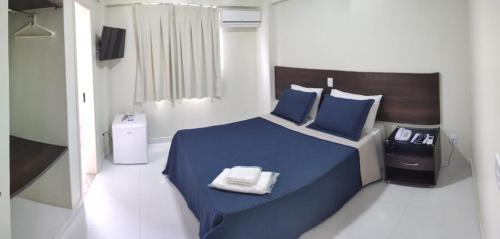 Cama ou camas em um quarto em Rametta Hotel