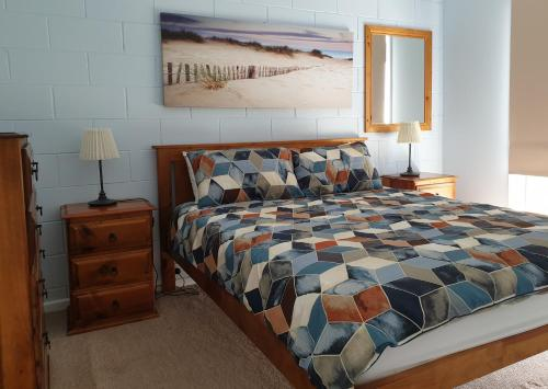 A bed or beds in a room at Marion Bay Holiday Villas
