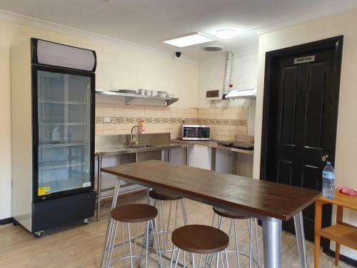 A kitchen or kitchenette at Clover Free Car Parking Hostel