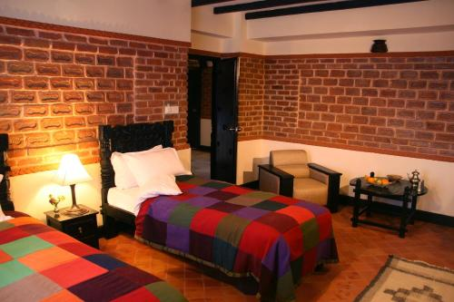 A bed or beds in a room at Hotel Heritage