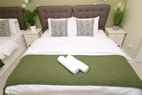 A bed or beds in a room at The Spinney