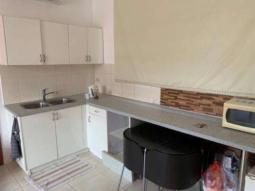 Een keuken of kitchenette bij Hogerhuysapartments
