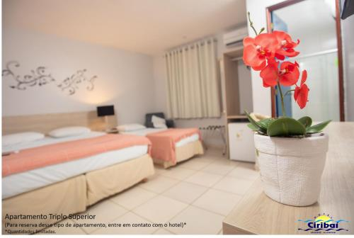 A bed or beds in a room at Hotel Ciribaí