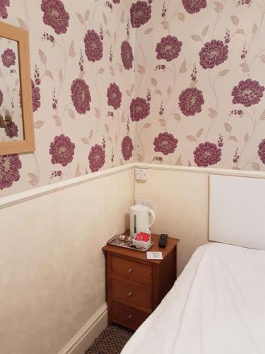 A bed or beds in a room at Tobermory Hotel