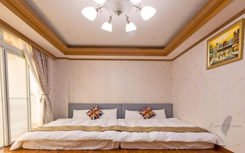 宿曦 Suxi House房間的床