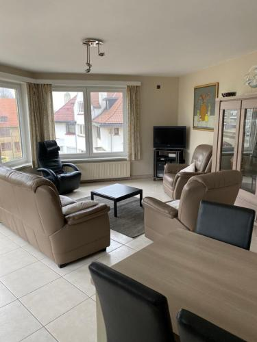 A seating area at Westhoek Apartments
