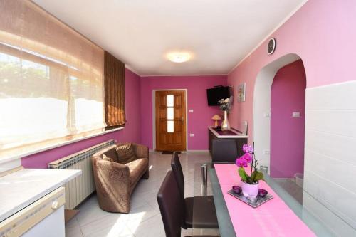 Area soggiorno di Apartments and Rooms Branka