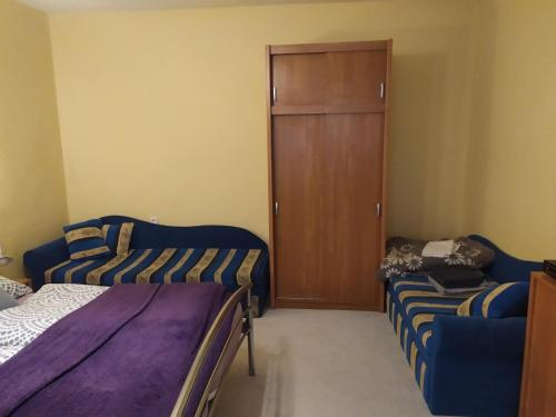 Posteľ alebo postele v izbe v ubytovaní Apartman Ola