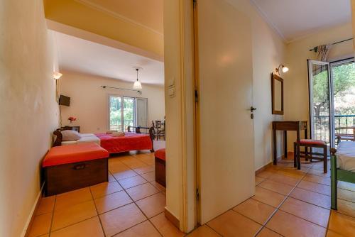 Ένα ή περισσότερα κρεβάτια σε δωμάτιο στο Villa San Andreas