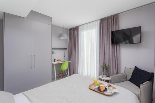 Ein Bett oder Betten in einem Zimmer der Unterkunft VISIONAPARTMENTS Neustadtstrasse - contactless check-in