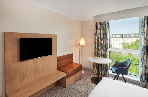 A television and/or entertainment center at Hilton London Croydon